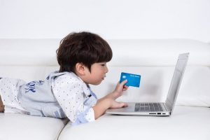 Family fraud a child making an in-app game purchase